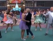 """Two women kiss during a performance of """"Build a Prom"""" at the Macy's Thanksgiving Day Parade"""