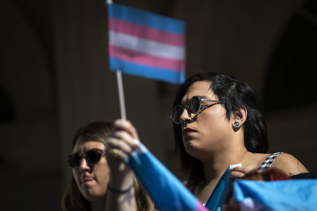 LGBT activists rally in support of transgender people on the steps of New York City Hall in October 2018