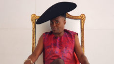 Billy Porter, wearing a dress and sat in a throne, speaks exclusively to PinkNews