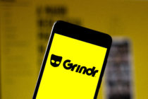 A Grindr logo seen displayed on a smartphone.