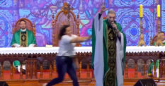 Woman pushes anti-gay priest off stage in Brazil