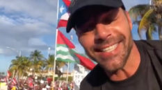 Ricky Martin in front of a Puerto Rican flag