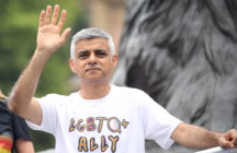 "Sadiq Khan waving, wearing an ""LGBTQ ally"" t-shirt"