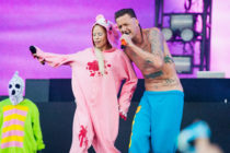 Die Antwoord's Yolandi in a pink onesie and Ninja in blue trousers